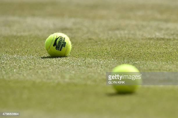 Tennis balls lie on No 1 court before Switzerland's Stan Wawrinka plays against Belgium's David Goffin during their men's singles fourth round match...