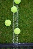 Tennis balls on tennis court