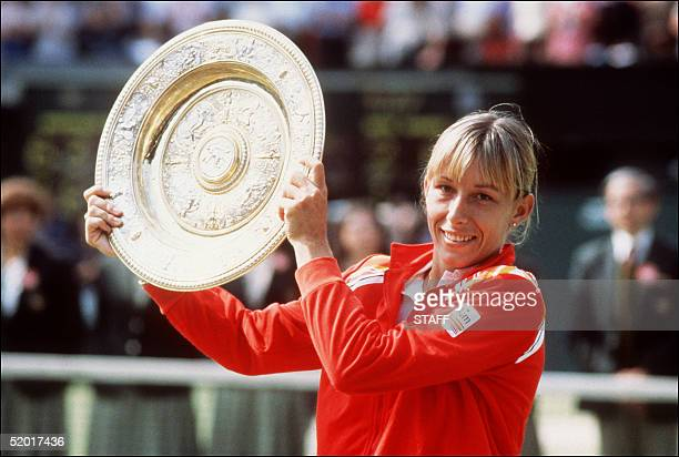 Tennis champion born Czech Martina Navratilova holds the trophy after winning July1982 the Ladies' Singles at Wimbledon for the third time beating...