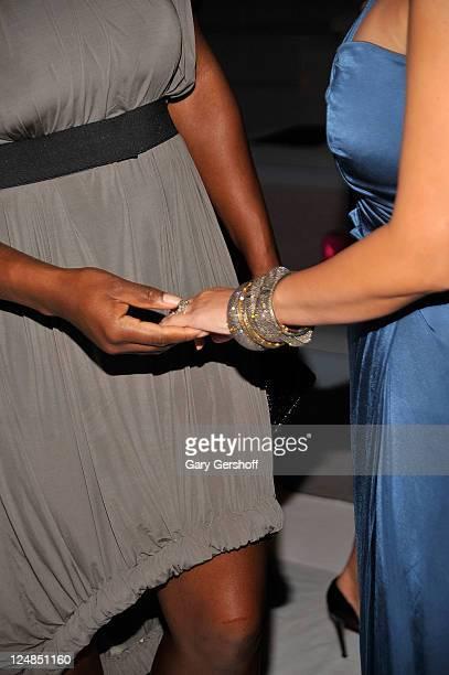 Tennis champion Serena Williams looks at the wedding ring of Kim Kardashian at the Vera Wang Spring 2012 fashion show during MercedesBenz Fashion...