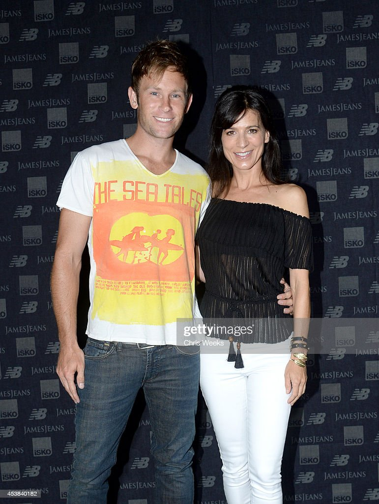 Tennis Coach Aaron Fox (L) and actress Perrey Reeves attend a dance party with New Balance and James Jeans powered by ISKO at the home of Pascal Mouwad on August 19, 2014 in Bel Air, California.
