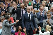 US tennis coach and broadcaster John McEnroe stands in the royal box on centre court as he is introduced on the sixth day of the 2016 Wimbledon...