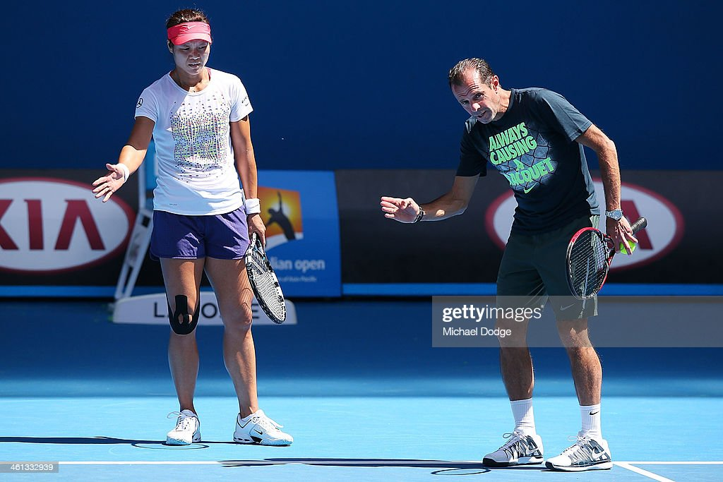 Tennis coach Carlos Rodriguez gestures to Li Na of China during a training session ahead of the 2014 Australian Open at Melbourne Park on January 8...