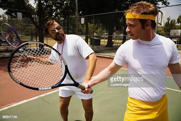 Tennis coach with man