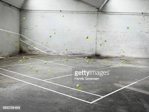 Tennis court filled with tennis balls