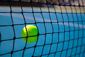 A stock photo of a Tennis ball being hit into the Net. Photographed using the Canon EOS 1DX Mark II