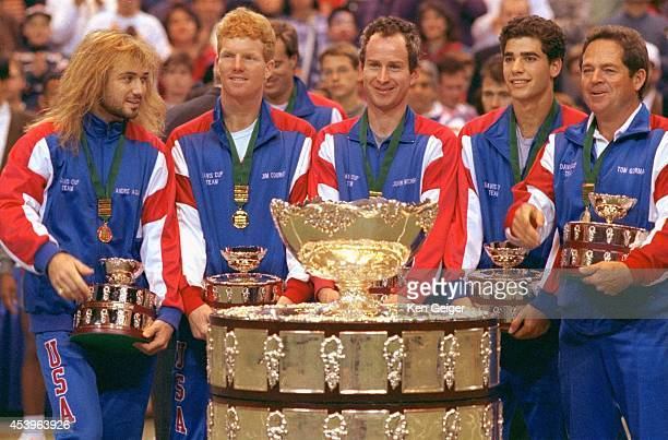 Davis Cup USA Andre Agassi Jim Courier John McEnroe Pete Sampras and captain Tom Gorman victorious with trophy after defeating Switzerland to win...