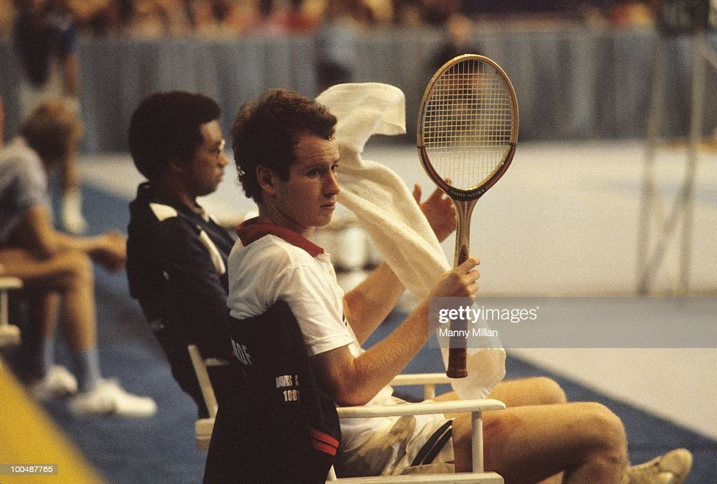 USA John McEnroe with captain Arthur Ashe on sidelines bench during Final vs Argentina at Riverfront Coliseum. Cincinnati, OH