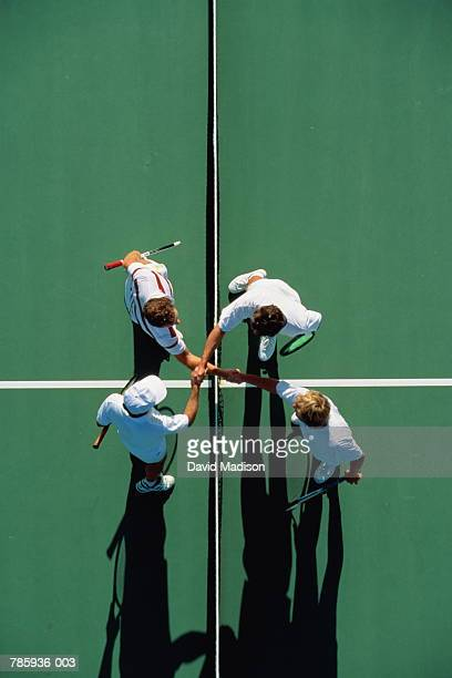 Tennis, doubles players shaking hands over net, overhead view