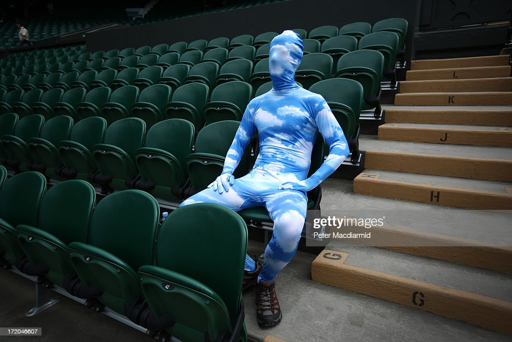 Tennis fan Chris Fava wears a blue sky body suit as he waits for the start of play on Centre Court on day seven of the Wimbledon Lawn Tennis Championships at the All England Lawn Tennis and Croquet Club on July 1, 2013 in London, England.