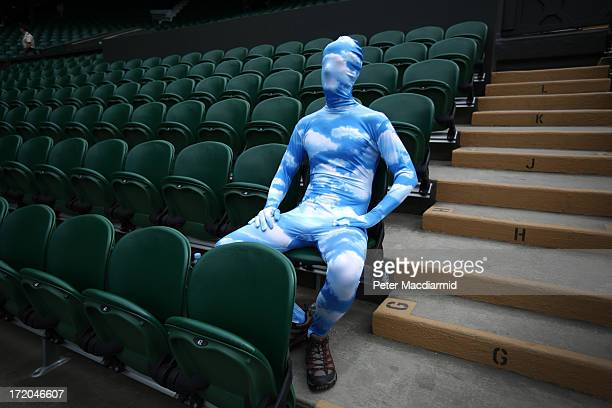 Tennis fan Chris Fava wears a blue sky body suit as he waits for the start of play on Centre Court on day seven of the Wimbledon Lawn Tennis...
