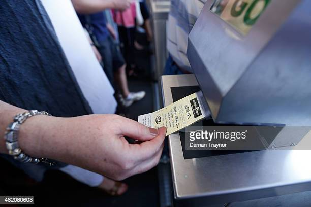 A tennis fan scans their ticket as they arrive for day one of the 2014 Australian Open at Melbourne Park on January 13 2014 in Melbourne Australia