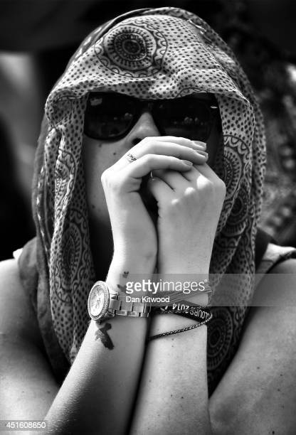 A tennis fan watches Britain's Andy Murray lose his Gentlemen's Singles quarterfinal match against Grigor Dimitrov of Bulgaria during the last game...