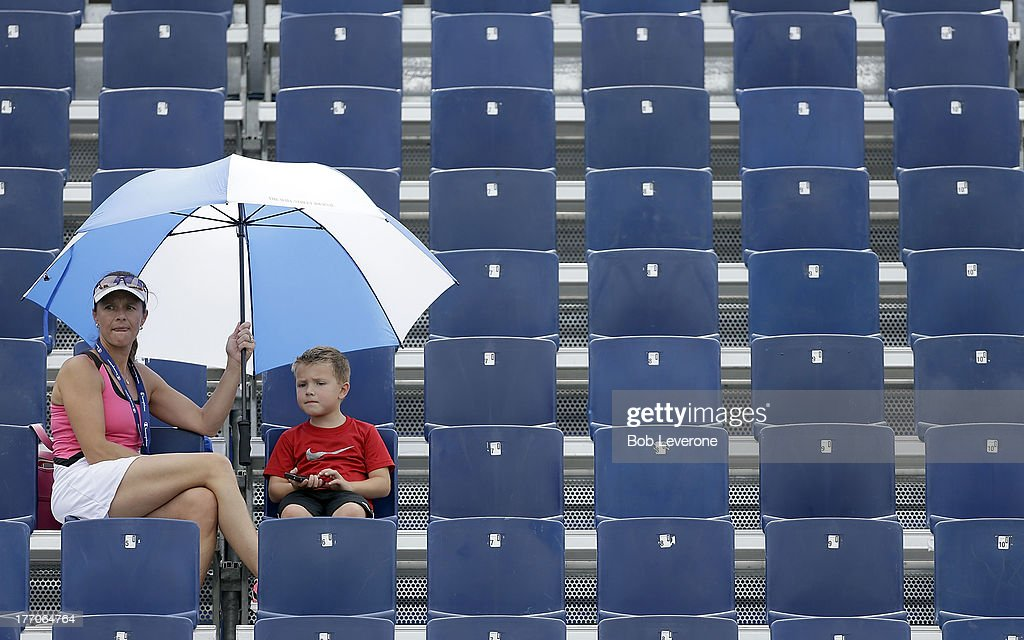 Tennis fans at the Winston-Salem Open broke out the umbrellas for shade instead of rain on August 20, 2013 in Winston Salem, North Carolina.
