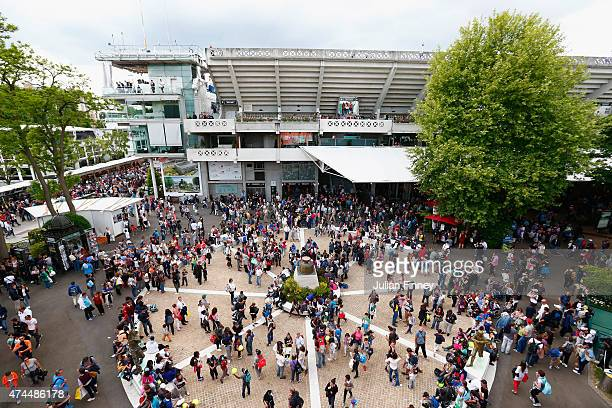 Tennis fans gather outside Philippe Chatrier court ahead of the 2015 French Open at Roland Garros on May 23 2015 in Paris France