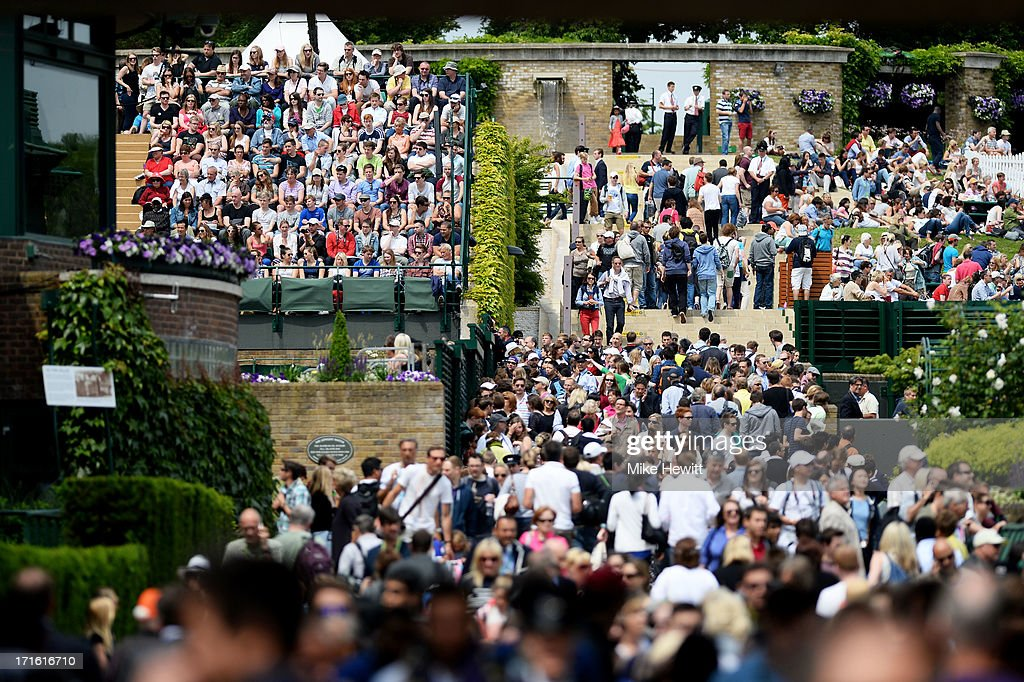 Tennis fans pack the path towards Murray Mound and Court 18 during day four of the Wimbledon Lawn Tennis Championships at the All England Lawn Tennis and Croquet Club on June 27, 2013 in London, England.