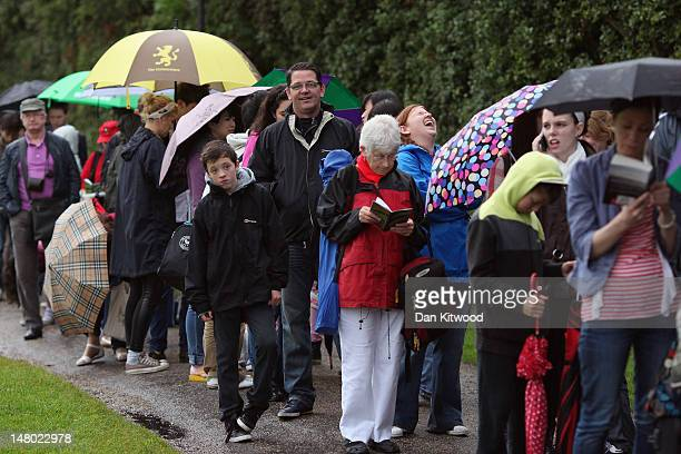 Tennis fans queue for a space on 'Murray Mount' to watch the men's final at Wimbledon on July 8 2012 in London England Andy Murray is the first...