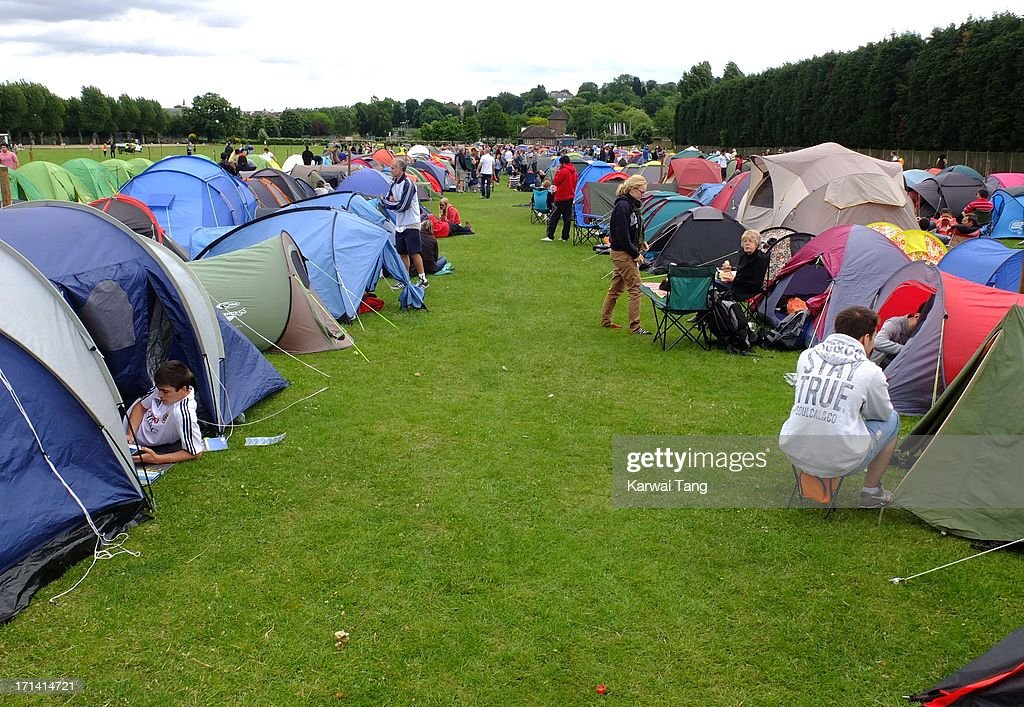 Tennis fans queue up overnight for Wimbledon tickets on June 23, 2013 in London, England.