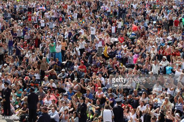 Tennis fans react during the first set on 'Murray Mount' on the final day at Wimbledon on July 8 2012 in London England Andy Murray is the first...