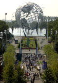 Tennis fans stream into the National Tennis Center with the Unisphere from the 1964 World's Fair in the background Saturday August 30 2003 at the...