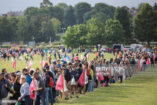 Tennis fans wait in line at the public queueing zone outside the All England Tennis Club on July 3 2017 in Wimbledon England Thousands of tennis fans...