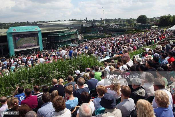 Tennis fans watch during the first set on 'Murray Mount' on the final day at Wimbledon on July 8 2012 in London England Andy Murray is the first...