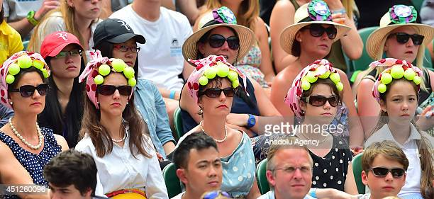 Tennis fans watch the men's singles second round match between Rafael Nadal of Spain and Lukas Rosol of Czech Republic on day four of the 2014...