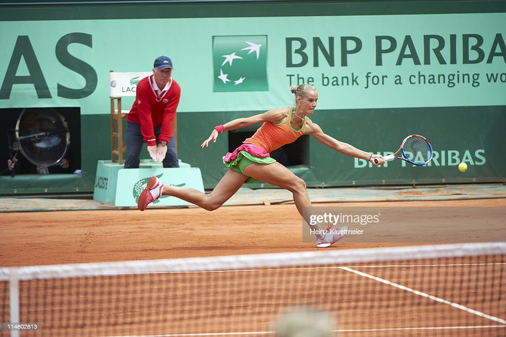 Netherlands <a gi-track='captionPersonalityLinkClicked' href=/galleries/search?phrase=Arantxa+Rus&family=editorial&specificpeople=4387294 ng-click='$event.stopPropagation()'>Arantxa Rus</a> in action vs Belgium Kim Clijsters during Women's 2nd Round at Stade Roland Garros. Heinz Kluetmeier F51 )