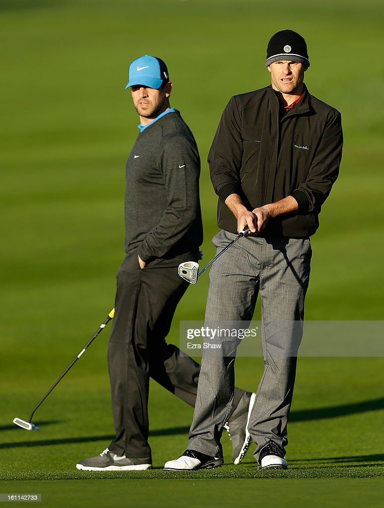 Tennis great Andy Roddick (R) watches a putt on the first hole as NFL player Aaron Rodgers looks on during the third round of the AT&T Pebble Beach National Pro-Am at Pebble Beach Golf Links on February 9, 2013 in Pebble Beach, California.
