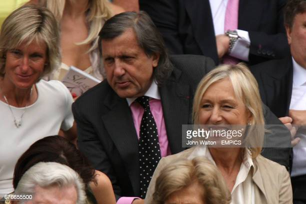 Tennis greats Martina Navratilova right and Illie Nastase sit in the Royal Box on Centre Court