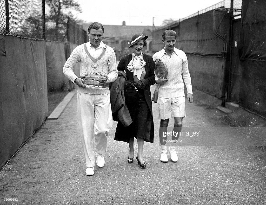 Tennis H W Bunny Austin right with his wife centre and Mr