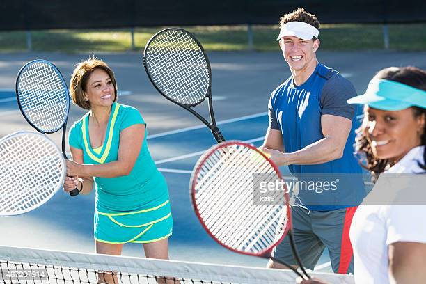 Tennis instructor with group of women