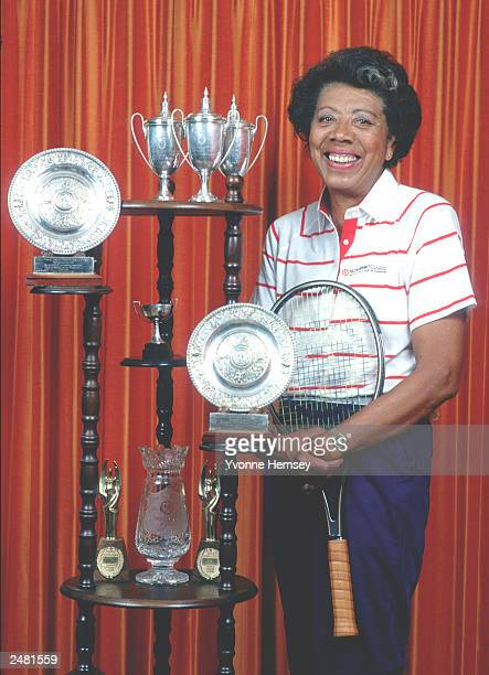 Tennis legend Althea Gibson poses for a portrait at her home surrounded by her trophies June 12 1987 in East Orange NJ