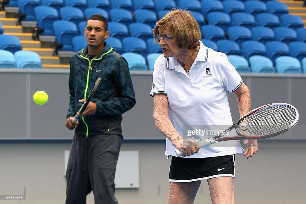 Tennis legend Margaret Court plays a shot as Australian tennis player Nick Kyrios looks on during the 2015 Australian Open launch at Melbourne Park...