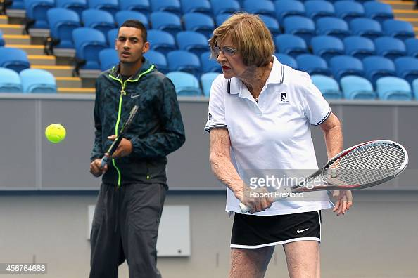 Tennis legend Margaret Court plays a shot as Australian tennis player Nick Kyrios looks on during the 2015 Australian Open launch at Melbourne Park...