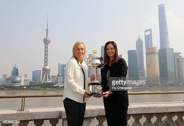 Tennis legend Martina Navratilova and tennis player Li Na of China hold the Australian Open Trophy during the Australian Open Women In Focus Lunch at...
