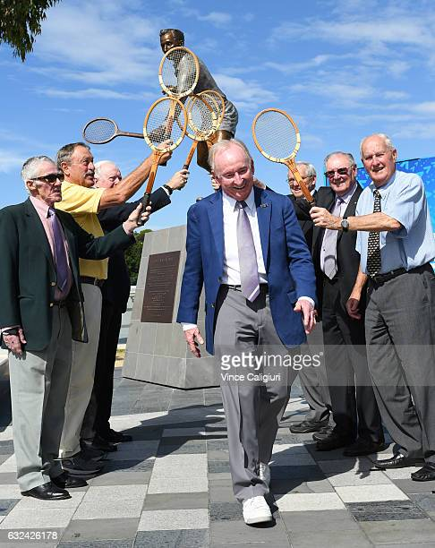 Tennis legends Ken Rosewall John Newcombe Fed Stolle Roy Emerson Frank Sedgman and Neale Fraser form a guard of honour for Australian legend Rod...