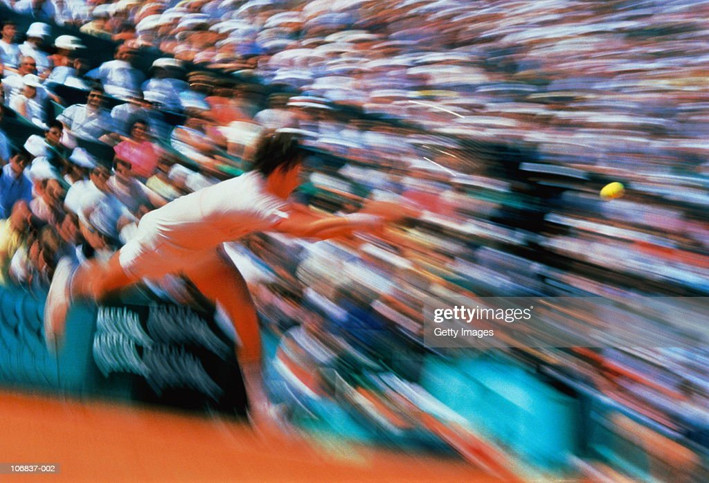 Tennis, male player hitting ball (zoom effect) : Stock Photo