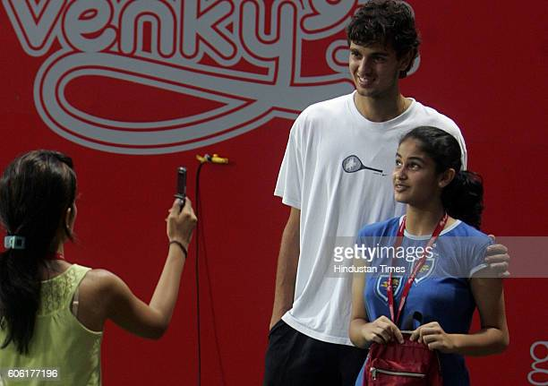 Tennis Mario Ancic of Croatia poses for a photograph for fans as rains washed out the finals of the Kingfisher Tennis Open at CCI on Sunday