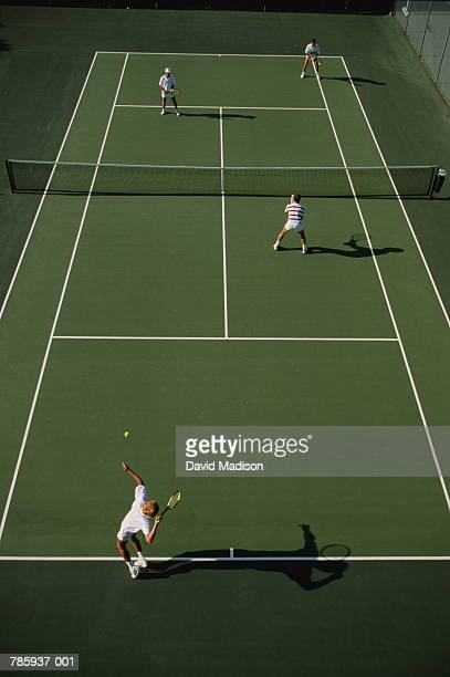 Tennis, men playing doubles on green court, elevated view
