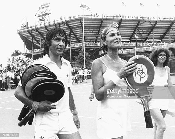 Tennis mixed doubles partner Renee Richards and Ilie Nastase leave the court after a match during the US Open Tennis Championships at Flushing Meadow...