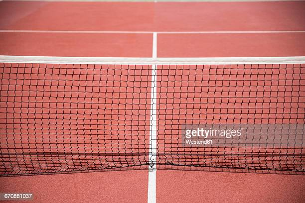 Tennis net on a clay court