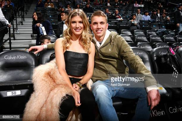Tennis payer Genie Bouchard poses for a picture with her date during the game between the Brooklyn Nets and the Milwaukee Bucks on February 15 2017...