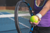 A stock photo of a woman playing Tennis.