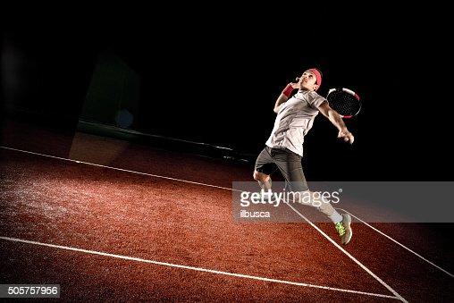 Tennis player action: Jumping smash