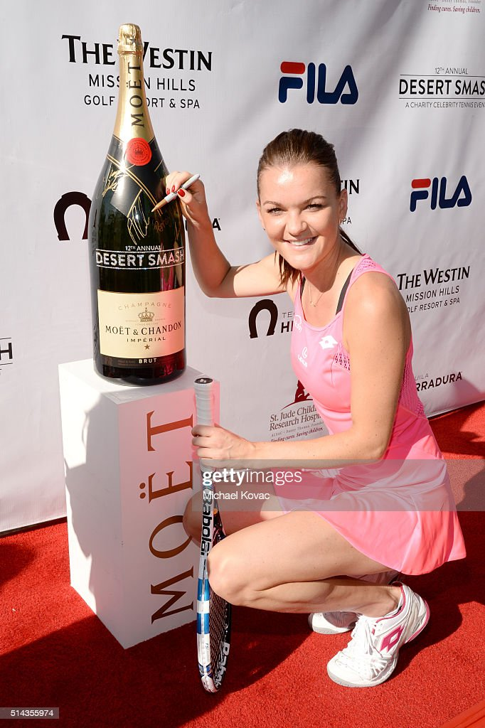 Tennis player Agnieszka Radwanska celebrates with Moet Chandon at the 12th annual Desert Smash at the Westin Mission Hills Golf Resort and Spa on...