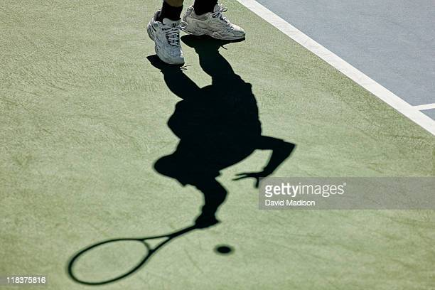 Tennis player and his shadow.