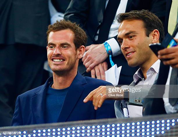 Tennis player Andy Murray L0 and Ross Hutchins look on from the stand prior toduring the UEFA Champions League Quarter Final second leg match between...