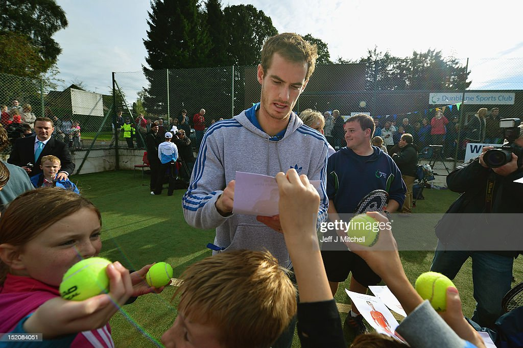 Tennis player <a gi-track='captionPersonalityLinkClicked' href=/galleries/search?phrase=Andy+Murray+-+Tennis+Player&family=editorial&specificpeople=200668 ng-click='$event.stopPropagation()'>Andy Murray</a> meets fans during a visit to Dunblane Sports Club, where he started playing tennis as a child, after he returned to Dunblane following his win in the US Open and his gold medal in the 2012 Olympic games in London, on September 16, 2012 in Dunblane, Scotland. Thousands lined the streets of his hometown as the 25 year old returned to meet with family and friends following his summer triumphs.