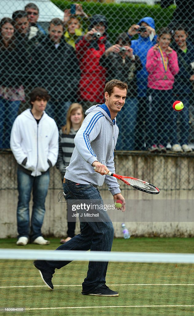 Tennis player <a gi-track='captionPersonalityLinkClicked' href=/galleries/search?phrase=Andy+Murray+-+Jogador+de+t%C3%A9nis&family=editorial&specificpeople=200668 ng-click='$event.stopPropagation()'>Andy Murray</a> meets fans during a visit to Dunblane Sports Club, where he started playing tennis as a child, after he returned to Dunblane following his win in the US Open and his gold medal in the 2012 Olympic games in London, on September 16, 2012 in Dunblane, Scotland. Thousands lined the streets of his hometown as the 25 year old returned to meet with family and friends following his summer triumphs.